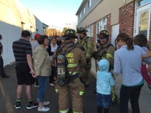 firemen greeting kids